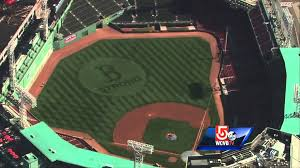 sox boston logo cut into grass at fenway park