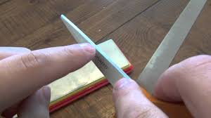 sharpening kitchen knives with a stone how to sharpen scissors youtube