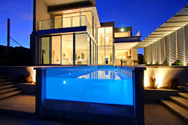swimming pool with glass wall also curtain wall in home design