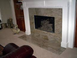 fireplace design with dark marble mantel and brick firebox