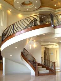 charming circular style staircase design with black iron banister