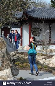 the first visitors walk through the chinese garden in weissensee