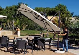 Outdoor Patio Set With Umbrella Offset Patio Umbrella Tips To Get The Right One Eva Furniture