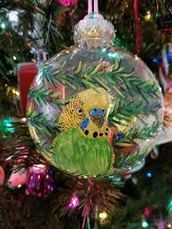 painted yellow green parakeet plastic tree