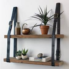 how cool is this repurposed belt wall shelf unit spied over at