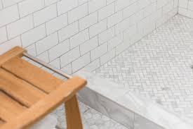 open shower with marble herringbone shower floor transitional
