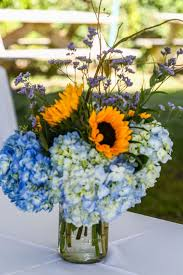 sunflower centerpieces blue hydrangea and sunflower centerpieces
