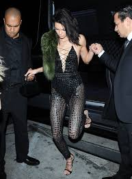 kendall jenner jumpsuit kendall jenner wears catsuit before changing into plunging