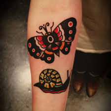 17 traditional snail tattoos and ideas
