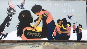 justseeds channels street art graffiti to immigrants with love mural