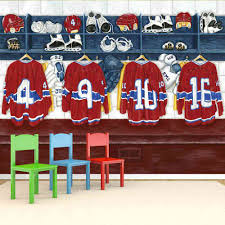 adding another hockey mural to celebrate the upcoming nhl season this kids wall mural is adorable with its red and blue hockey jerseys hanging in the locker room hockey wall murals are perfect for a bedroom or playroom