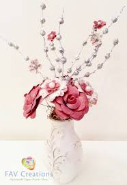 red and off white paper flowers in vintage vase home decor