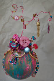 whimsical ornament using old bracelet charms buttons wired