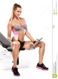 nice woman sitting on a bench and workout with dumbbell stock