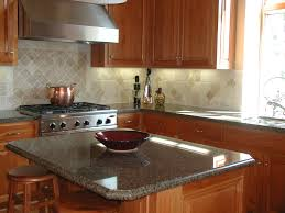 grey garnite countertops connected by beige tile backsplash and
