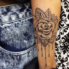 girly arm with tattoos inked