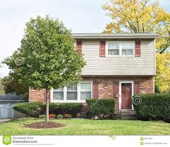 small two story house with front crabapple tree stock photo