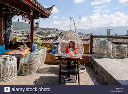 Patio Egg Chair Oriental Woman Tourist Relaxing In Egg Chair On Rooftop Patio With
