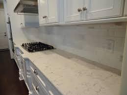 soapstone tile backsplash sink faucet kitchen white cabinets stone