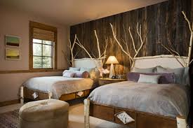 rustic bedroom ideas natural stone wall black canopy bed wood