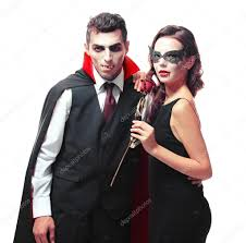 young couple dressed in vampire costumes for halloween isolated