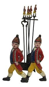 antique cast iron hessian soldier andirons and fireplace set