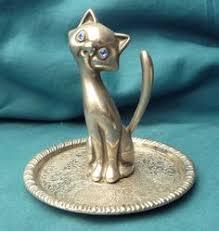 vintage seba silver toned cat on green circular base ring holder