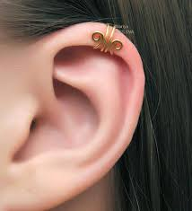 earrings on top of ear gold scroll swirls helix ear cuff cartilage ear cuff piercing
