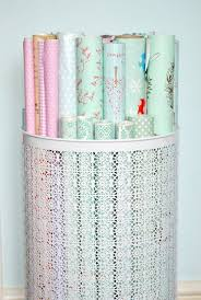 decorative wrapping paper use a decorative laundry basket to organize wrapping paper wrap