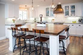 white kitchen wood island kitchen cabinets with wood floors black metal