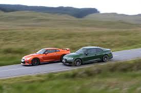 nissan gtr vs audi r8 new audi rs5 vs nissan gt r two super coupes do battle in