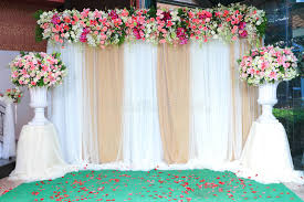 wedding backdrop gold colorful backdrop flowers with white and gold fabric arrangement
