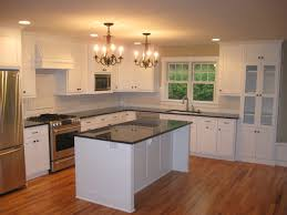corner white wooden kitchen cabinet with glass doors combined with