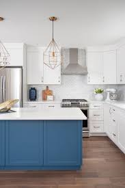 white kitchen cabinets with blue island 27 marble herringbone backsplash marble white