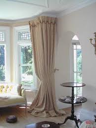 cream curtain also white bay window frame also round coffe table