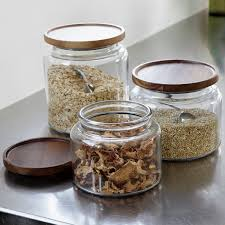 a beautiful acacia wood lid adds natural warmth to the classic a beautiful acacia wood lid adds natural warmth to the classic glass canister for storage and