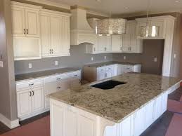 Kitchen Backsplash With White Cabinets by Kitchen Cabinets White Cabinets With Tan Corian Countertops Retro