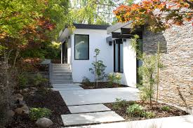 Atrium House by Klopf Architecture Replaced A Dilapidated 1940s House With A