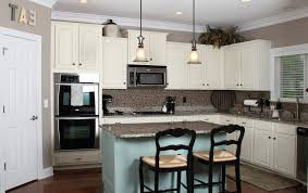 gray kitchen cabinets wall color cream color of cooker hood by double black barstools white