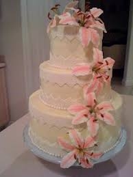 wedding cake gum stargazer lillies on wedding cake
