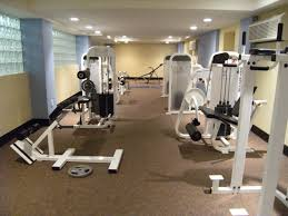 home gym interior design ideas carpet floors and gym equipments with glass block for home