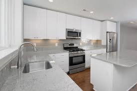 slab door kitchen cabinets choice cabinetry flintstone marble and granite