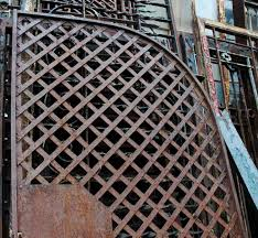 antique wrought iron gate or woven lattice garden trellis olde