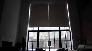 custom motorized roman shades over 20ft window in tribeca