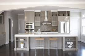 top grey cabinets with black counters wood floors countertops