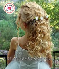 flower girl hair flower pull back hairstyle