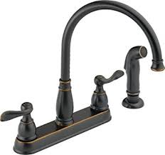 amazon delta kitchen faucets delta foundations 21996lf ob two handle kitchen faucet with spray