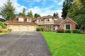 Three Car Garage Luxury House Exterior With Brick Trim Tile Roof And French