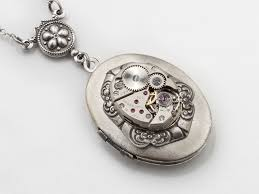ladies necklace watch images Steampunk necklace with silver oval locket and watch movement with jpg