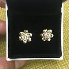 rositas earrings 4 1 grams rositas earrings surrounded with 14 karat gold petals